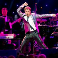 Cliff-Richard-performs-during-the-World-Hunger-Day-concert-with-Dionne-Warwick-and-friends-at-The-Royal-Albert-Hall